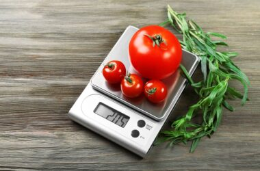 Tomatoes on digital kitchen scales
